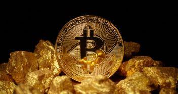 KaratBank Coin: Münze einer Kryptowährung liegt auf Gold Nuggets